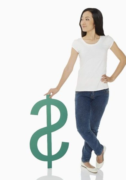 Cheerful woman standing with a dollar sign